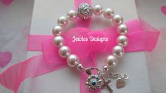 A personal favorite from my Etsy shop https://www.etsy.com/ca/listing/103478932/infant-jewelry-swarovski-baby-bracelet