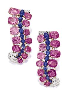 Cartier: pair of pink sapphire, sapphire and diamond brooches, Circa 1950.  Sotheby's Magnificent Jewel & Jadeite Auction, April 2014.