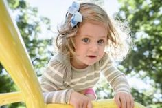 Two Year Old Girl at Play - Robert Kirk/Photodisc/Getty Images