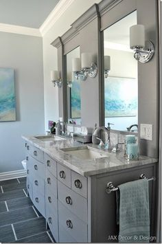 Super White Quartzite bathroom vanity with grey cabinets. visit globalgranite.com for your natural stone needs.