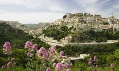 Ragusa, Sicily ... 'sandstone houses, domes and towers spill down its ...