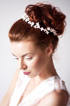 Made to your order  Romantic flowers Bridal headband.   Each beautiful flower is carefully hand sculpted and created with lots of love!    All