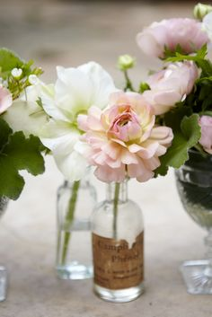 center piece; simple flowers in old bottles