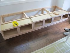 Cool idea for a banquette: basic upper cabinets, raised on a two-by-four base, framed out, and topped with plywood.  Paint it, put the doors on, and add some cushions, and you're set!