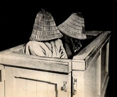 Two japanese women (or men) hiding their faces in baskets of a Tokyo Courtroom, 1922 - usually prior to receiving death sentences for serious crimes. Japan. S)