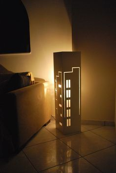 Skyline Lamp. Handmade cutout lamp showing 4 facades of a building.Design  by Ioannis