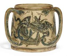 "Martin Brothers Pottery - Robert Wallace Martin (1843-1923) - Three-Handled Dragons Tyg. Incised, Painted & Glazed Stoneware. Southall, Middlesex, England. Circa 1911. 5-7/8"" x 6-1/8""."