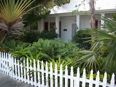 """Tennessee Williams' home in Key West, FL  His home is unmarked and untoured. You would have to google his name to find the address but once you show up outside the house you might wonder if you're at the right place, so unobtrusive and modest the property.    A one room bungalow, the property sits only a few feet from the street as do many of the homes in Key West... Tennessee Williams himself apparently called his little home at the End of the World """"Mad House."""""""