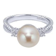 14kt white gold diamond and 7mm white pearl ring. # 325-50-2460 * In Stock…