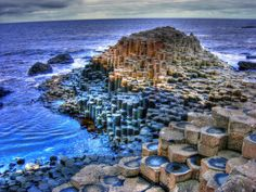 Giants Causeway, Ireland - While the image has been PhotoShop-ed for effect, this beautiful, surreal place does exist.
