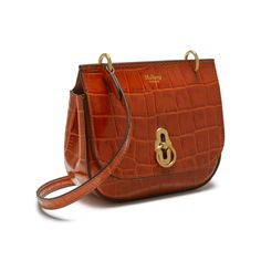 Shop the Mini Amberley Satchel in Red Fox Croc Print Leather at Mulberry.com. Meet the miniature addition to the Amberley family. The Mini Amberley Satchel maintains all the same elegant features and functionalities as its larger counterpart, but on a minature scale. The distinctive geometrical rider's lock is a reinterpretation of our iconic postman's lock, inspired by equestrian styling.