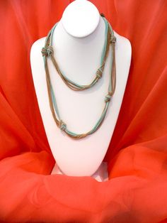 Love the contrast between suede and gold chains!