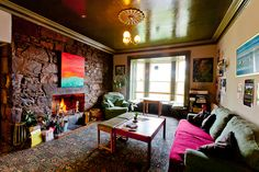 Our cosy lounge room with a real log fire, free WiFi and as much free hot chocolate as you can drink!