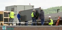Workers install solar panels on Gundersen's Onalaska, WI renal dialysis center.