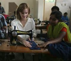 Emma Watson sewing at Swallow in Bangladesh, a sewing cooperative where 200 women work making People Tree clothes, a fair trade company.