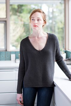 Embrace the weekend in a slouchy V-neck that makes the most of Arbor's superior stitch definition. Harlowe is built to drape and move, with a fluid fabric studded with purl stitches for subtle interest. The hems are knit separately from a tubular single-rib edge — longer in the back — and shaped with increases that subtly open deep side vents. Above the vents, the straight torso is worked in the round. Long, slim sleeves are also worked circularly from the cuff upward. An edging of gently…