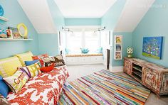 happy, bright room with snazzy rainbow rug