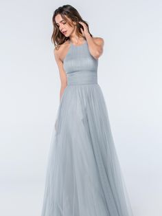 This stunning grey/blue floaty dress from the Watters Bridesmaids collection has been beautifully designed with a high halter neckline and bobbinet skirt. Product name Abigale 2302 in French Blue.  View more Bridesmaid dresses from our Watters collection at: http://www.baroqueboutique.co.uk/bridesmaids/  Photographs courtesy of: https://www.watters.com/watters/bridesmaids/