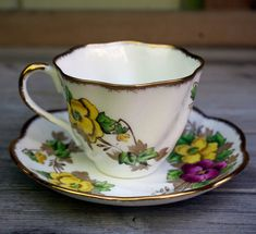 Salisbury fine bone chine, Pansy, teacup and saucer, made in England. The tea cup is about 3 high and 3-1/4 across the top. The saucer is 5.75 diameter. Both are in very good condition - no chips, cracks, crazing or repairs. Happy to ship internationally, contact me for shipping