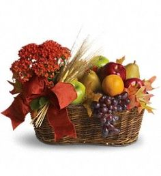 Fresh Picked...Whoever is lucky enough to receive this gift will know you've picked it just for them. So delightful. So delicious. So different. It's the perfect blend of beauty and bounty!  A live kalanchoe potted plant is surrounded by fresh pears, red and green apples, red grapes and tangerines. Add some wheat stalks and a pretty taffeta ribbon and what you've got is a basket full of goodness.