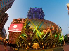 Stay in a Hotel Shaped Like a Crocodile (and Other Hotel Oddities) - Condé Nast Traveler  Grand Lisboa Hotel — Macau, China Like a giant lotus flower sprouting from the center of Macau, the Grand Lisboa Hotel is a sight to behold. With 47 floors, it's the tallest building on the peninsula. The hotel is also home to a casino and the Star of Stanley Ho, a 218.08-carat diamond. (© Bob Henry / Alamy)