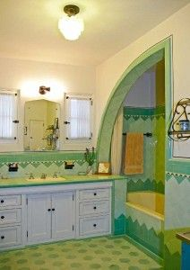 This brilliant bathroom, original to the 1933 Spanish-style bungalow, features green tiles and buttery fixtures. Photo: Jaimee Itagaki