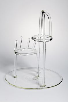 TANDEM designed by Charlotte Juillard - An hybrid object made of two complementary elements creates a curiously sculptural ornamental vase. The glass become not just a support for flowers but has a new function, becoming a visual and useful tool – the glass rods drawing the form. #drawingglass #fabricadesignstudio #fabrica #design #glass #charlottejuillard #massimolunardon