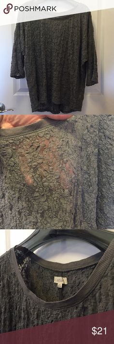 """LIKE NEW! Aerie stretchy lace gray lace top Sz XL Only worn once...maybe not at all! But I took the tags off. Aerie sheer lace scoop neck top. The lace has a """"chunky"""" texture and gets flatter the tighter it is. Sleeve is elbow length and has a slight dolman cut. Fabric is VERY stretchy. Sheer enough you definitely need a cami underneath. Nice medium grey color. Size XL. Check out my closet for more L/XL and 14/16 clothing. Bundles are only 2 items! Bundle and make a nice deal for yourself or…"""