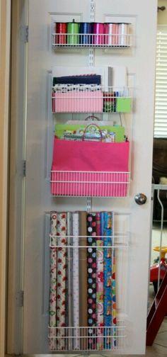 Gift wrap organizer using elfa over door rack.   Media bin holds wrap up!