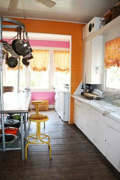 LOVE the outdoor siding inside the kitchen!  my next door neighbor's kitchen is like that and i love!