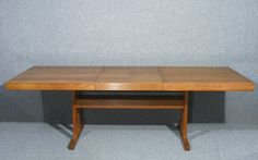 A superb vintage retro Danish design teak extending dining table  Seats 4-8  The table Combines great design and quality construction  Table extends via concealed leaf which is stored inside the table  Superb colour, grain and sheen to the teak table surface  Stands on sturdy square legs united by central stretchers  Measures approx 71 cms High 168 cms - 229 cms Wide 91 cms Deep
