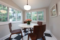 A small sunroom became a dining room in Paul and Angela's reno. The light keeps it form feeling small (even though it is) Income Property, Investment Property, Scott Mcgillivray, Small Sunroom, White Trim, Black White, Apartment Living, Dining Room, Room Decor