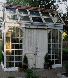 Greenhouse from old windows~ the back & peak of the roof shingle, windows in the front... Oh yeah.