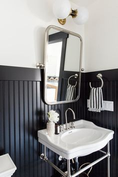 charming powder room featuring black beadboard by Studio McGee Black Wainscoting, Painted Wainscoting, Wainscoting Bedroom, Wainscoting Ideas, Bathroom Beadboard, Wainscoting Kitchen, Wainscoating Bathroom, Beadboard Wainscoting, Bathroom Paneling