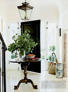 I'm in love with the high gloss black door and the white washed floor. Featured in House Beautiful 2012.