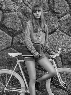 Girl and Bicycle | the book | fashion editorial |shorts | shirt | boots | street style | fashion | Vintage handbag |girl | model |