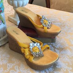 """GUC Yellow Miss Me wedges Sooo cute and girly . Pretty yellow inner soles and straps with a faux crystal studded (non-functioning) buckle! The wedge measures 3-1/2"""" and the front platform is 1"""" for comfort walking! Some wear on soles as shown. Perfect for spring and summer!  Miss Me Shoes Wedges"""