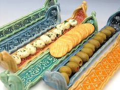 This serving tray is perfect for Olives, crackers, cheese or any appetizers. This listing is for one tray. See detail pictures on the right to see the tray in this listing Approx Dimensions: 14 x 2.75x 2.75 I always feel food looks more delicious when it is presented in a dish that enhances its look. These decorative trays were made specifically for this purpose, decorated with designs inspired by Indian embroidered fabrics and henna designs. Makes me hungry just looking at it. Food/d...