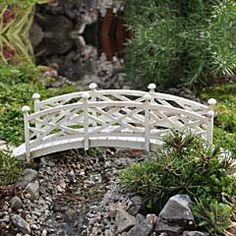 Tiny bridge for a miniature fairy garden. I'm not sure I can recreate something as cool as this arch, but maybe with some balsa wood, I could do a decent straight-across bridge.