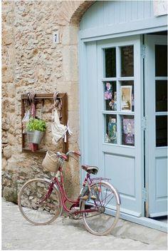 Bicycle blue door.