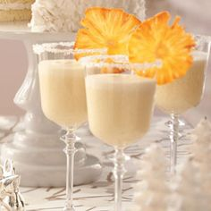 Frosty Pineapple Punch (•1 can (46 ounces) unsweetened pineapple juice, chilled •1 can (15 ounces) cream of coconut •1 quart vanilla ice cream •1 bottle (1 liter) club soda, chilled)
