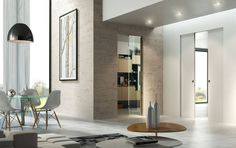 This frame was patented as an exclusive by Scrigno, and is a system that allows a sliding door to completely disappear, perfectly matching the wall. Flush Doors, Interior Desing, News Space, Sliding Doors, My Dream Home, Oversized Mirror, Essentials, Furniture, Home