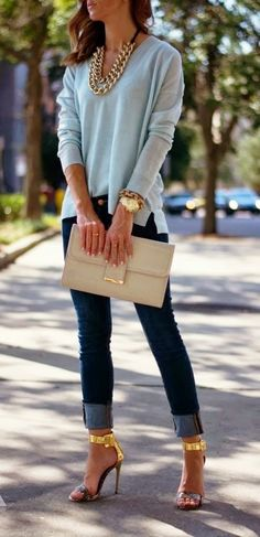 Classic look with gold accessories ; high heels, clutch, necklace and bracelets