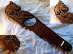 Lyre/Kantele with handcarved Gokstad dragon head as used by Valravn and Asynje. 5 steel strings, handcast bronze tailpiece in the shape of a Thors hammer. Medieval Music, Medieval Fantasy, Cigar Box Guitar, Viking Culture, Norse Vikings, Carving Designs, Viking Age, Anglo Saxon, Folk Music