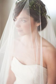 I'm in LOVE with her veil. Although I'm not sure if I want the over-the-face look or if I just want to tuck it underneath my updo
