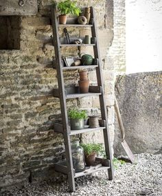 A gorgeously rustic farmhouse ladder shelf.This rustic wooden Shelf Ladder is great outdoors as a decorative stand for plant pots or as a useful additional storage unit for any potting shed or greenhouse but would look marvellous indoors too for a more rustic relaxed style of interior. The shelves fold flat for shipping and easily pivot on a screw.woodH178cm x W49cm x D40cm