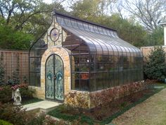 Greenhouse conservatory. Stained glass doors! ....Oh My ! I dream of having one like this on my property ....so wonderful !