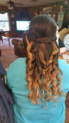 Braids pinned halfway with curls