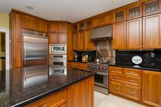 light cherry kitchen cabinets. Natural cherry cabinetry is found in the kitchen with full height upper  light cabinets what color countertops well coupled