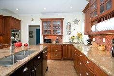 Shiloh Richmond cabinets in RED CHERRY/NO GLAZE w/ slab drawers and glass fronts